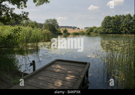 jetty over lake in staffordshire - Stock Photo