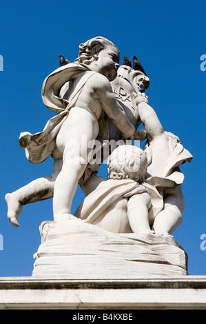 Statue on the Fontana dei Putti, Piazza dei Miracoli, Pisa, Tuscany, Italy - Stock Photo