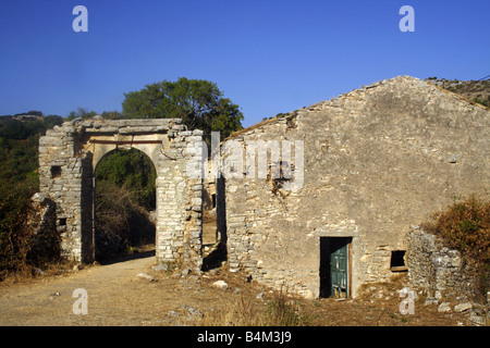 Abandoned and derelict stone houses in USESCO world heritage site of Old Perithia in Corfu, Greece - Stock Photo