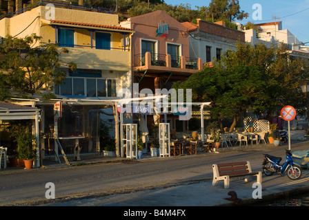 Shops Cafes and Restaurants in Voukari Town Isle of Kea Cyclades Islands Greece in early Morning Sunshine - Stock Photo