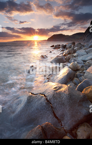 The Jurassic coast at sunset with 'Golden Cap' in the distance, Dorset, England, UK - Stock Photo