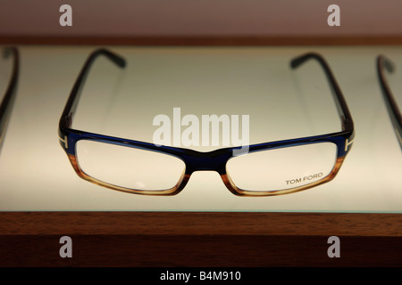 Designer Spectacle Glasses on display in a Trendy High Street Opticians Shop - Stock Photo