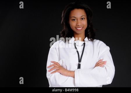 Lovely young and beautiful black Doctor or Nurse - Stock Photo