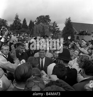 President John F Kennedy on a vist to England July 1963 walks through a crowd of well wishers surroundeed by police - Stock Photo