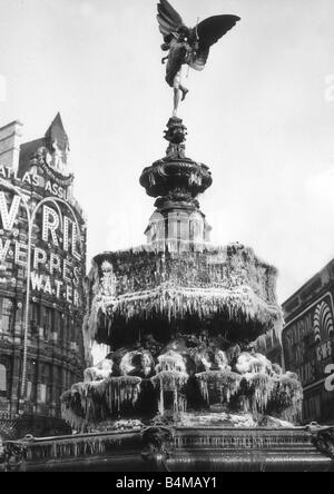 The statue of Eros in Piccadilly Circus London covered in frozen icicles February 1956 - Stock Photo