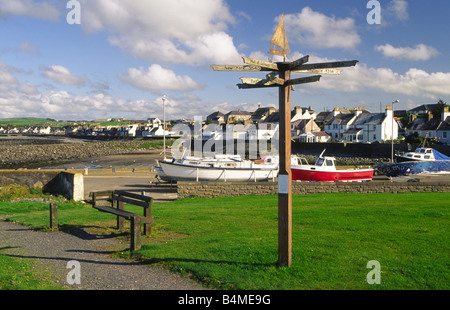 Port William harbour on the edge of Luce Bay in the Machars of Galloway coast direction and distance sign post Scotland - Stock Photo