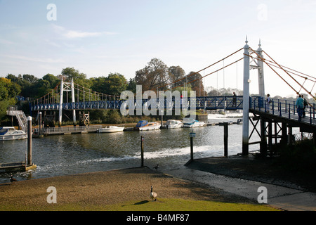 Footbridge crossing the River Thames at Teddington, London - Stock Photo