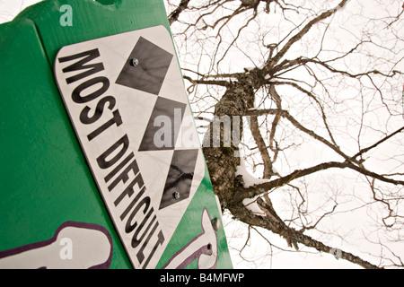 A sign marks a triple black diamond ski run at Mount Bohemia ski resort in Michigans Upper Peninsula - Stock Photo