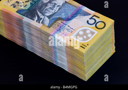 Stacked currency A$20,000 twenty thousand Australian dollars in $50 bills - Stock Photo