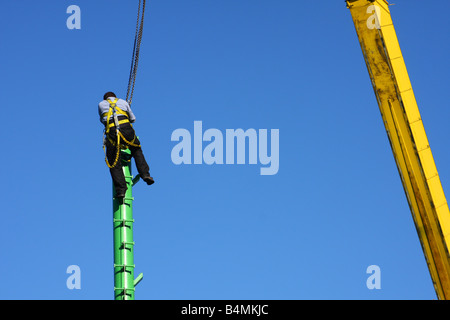 A construction worker in a U.K. city. - Stock Photo