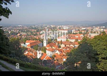 Old town of Slovenian Capital Ljubljana  St James s and St Florian s churches in foreground Slovenia Europe - Stock Photo