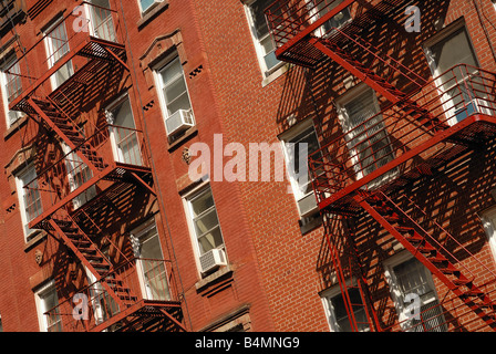 A New York neighborhood brick apartment as viewed from the street. - Stock Photo