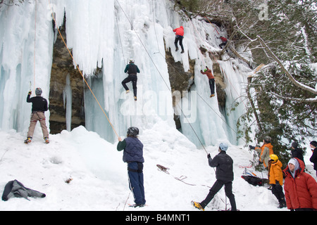 Ice climbing during Michigan Ice Fest at Pictured Rocks National Lakeshore in Munising Michigan Upper Peninsula - Stock Photo