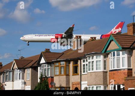 Virgin Atlantic Airbus plane landing at London airport. (40) - Stock Photo