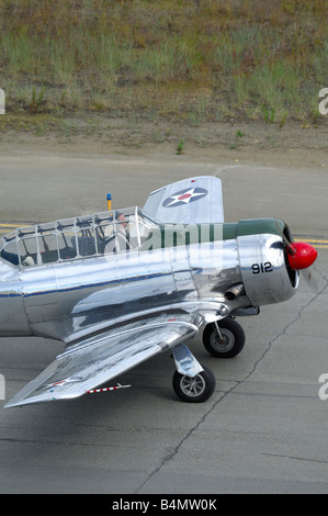 Old trainer plane North American AT-6 Texan on the taxyway during an airshow in Alaska - Stock Photo