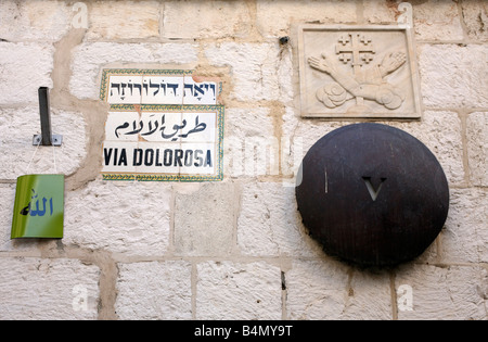 Signs and markers along the Via Dolorosa Way of Suffering in the old city of Jerusalem - Stock Photo