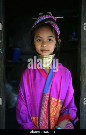 Portrait of a young Longneck girl in colorful traditional dress Approximately 300 Burmese refugees in Thailand are - Stock Photo