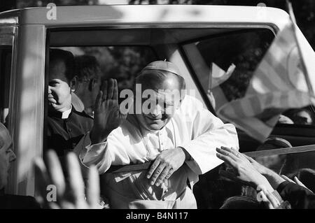 Pope John Paul II waves to the congregation from his pope mobile following an open air mass held at Wembley Stadium - Stock Photo