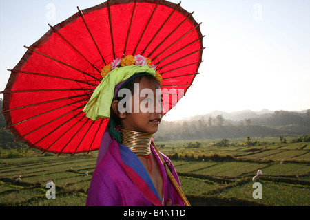 Closeup of girl walking with a parasol through the rice fields outside the Longneck village Approximately 300 Burmese - Stock Photo