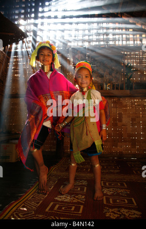 Two young Longneck girls wearing traditional dress indoors Approximately 300 Burmese refugees in Thailand are members - Stock Photo