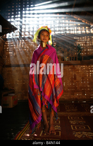 Portrait of a Longneck girl in traditional dress Approximately 300 Burmese refugees in Thailand are members of the - Stock Photo
