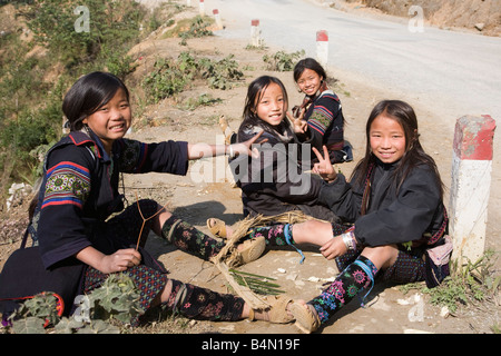 Portrait of Black Hmong girls in traditional dress making handicrafts, Sapa, Vietnam - Stock Photo