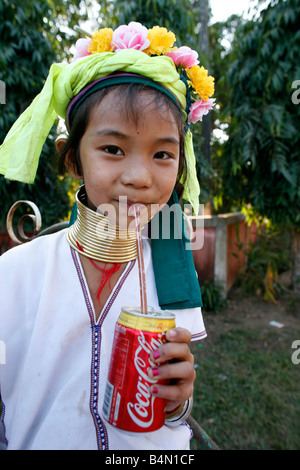 Closeup of a Longneck girl drinking a Coke Approximately 300 Burmese refugees in Thailand are members of the indigenous - Stock Photo