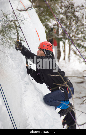 Ice climbing during Michigan Ice Fest at Pictured Rocks National Lakeshore in Munising Michigan Upper Peninsula - Stock Photo
