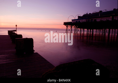 Sunrise on cleethorpes beach with pier and jetty near Grimsby south Humberside north east Lincolnshire flat sea - Stock Photo