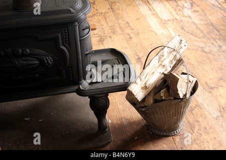An old wood stove to heat an 1860 pioneer school house - Stock Photo