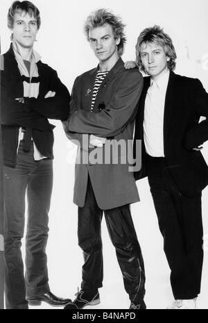 Police pop group January 1980 Pictured in Daily Mirror studio Stuart Copland Sting Andy Summers Arms folded - Stock Photo