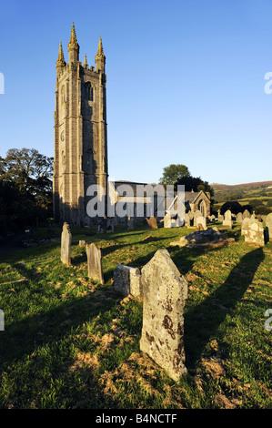 Sun sets over St Pancras Church, Widecome in the Moor, Dartmoor, Devon. - Stock Photo