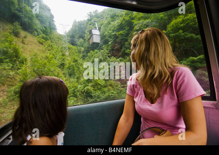 Mother and daughter ride a mountain cable car while visiting Pipestem Resort State Park in West Virginian - Stock Photo