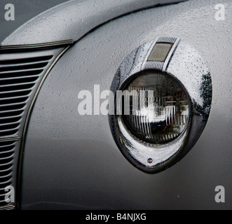Detail shot of the left headlamp of a 1940's Ford Coupe. - Stock Photo