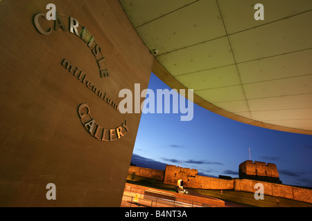 City of Carlisle, England. Night view of the Tullie House Museum & Art Gallery entrance with Carlisle Castle in - Stock Photo