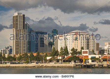 Downtown towers over Embarcadero waterfront in San Diego seen from excursion boat on San Diego Bay California USA - Stock Photo