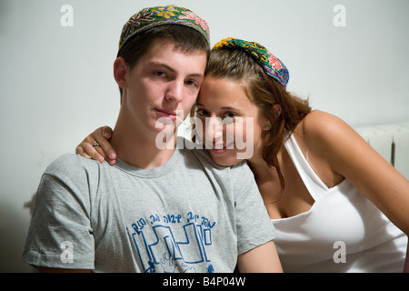 Young Jewish Woman and Man Wearing a Tradition Bukharian Hand Made and Embroided Kippah - Stock Photo