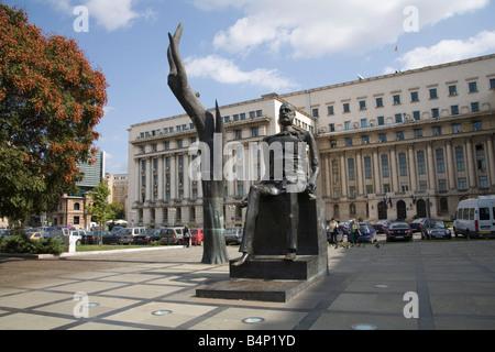Bucharest Romania Europe EU Hand and Bronze statue of Iuliu Maniu politician known as the Broken Man in Revolution - Stock Photo