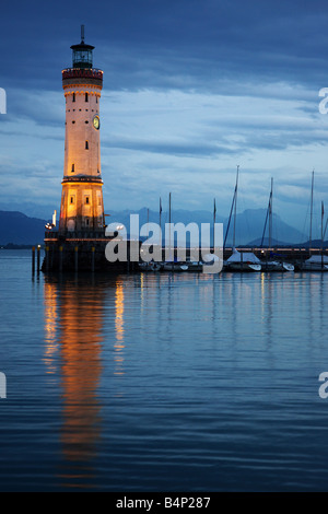 The lighthouse of Lindau Germany by night - Stock Photo
