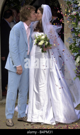 Jamie Oliver with new wife Juliette June 2000 at their wedding at Rickling Essex Kissing outside the church Jules - Stock Photo