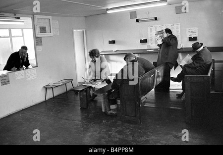 Punters seated on church pews as they study the guide before placing a bet at Mac s betting shop in Danesmoor near - Stock Photo