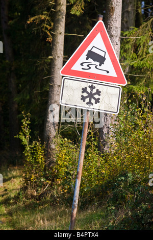 Slippery road sign snow, Bergishes land, Germany. - Stock Photo