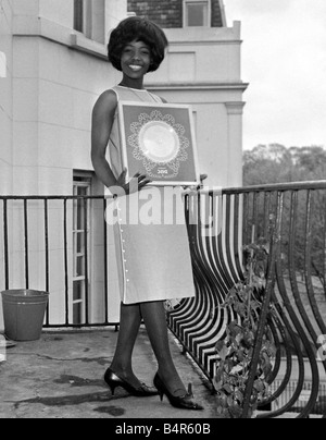 Millie Small Dynamic pop singer of My Boy Lollipop at a reception at Fontana Records where she received her silver - Stock Photo