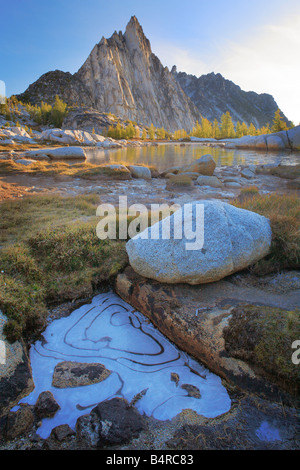 Frozen puddle near Gnome Tarn and Prusik Peak in the Enchantment Lakes area of Alpine Lakes Wilderness, Washington - Stock Photo
