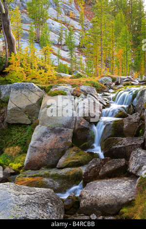 Small waterfall between Perfection and Leprechaun lakes in the Enchantment Lakes area of Alpine Lakes Wilderness, - Stock Photo