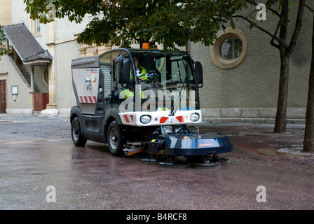 Street sweeper cleaning European village streets - Stock Photo
