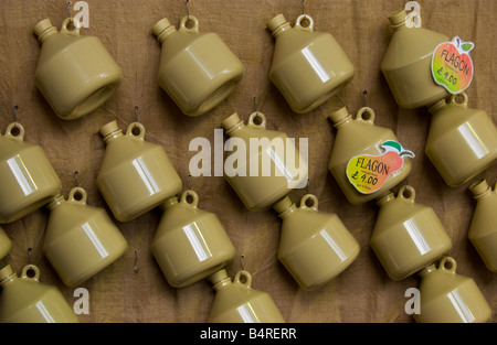 Cider and perry jugs on wall at Abergavenny Food Festival - Stock Photo