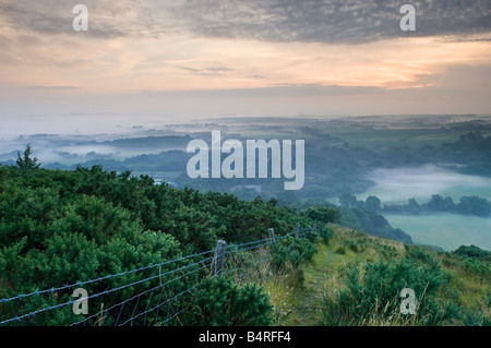 Sunrise on summer morning from West Hill at Corfe Castle Dorset England UK - Stock Photo