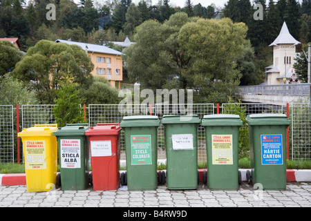 Romania Europe Line of coloured Wheelie bins for recycling - Stock Photo