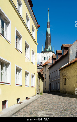 View of street in old town of Tallinn, Estonia, with steeple of St. Olaf's church - Stock Photo